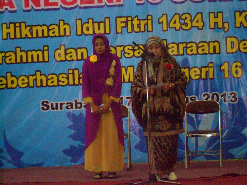 Pembaca Ayat Suci Alqur'an dan Sari Tilawah Ibu Dra. Hj. Enny Purwati